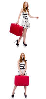 Young beautiful woman with red suitcase