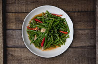 Top view Thai food stir fried morning glory on rustic wooden table