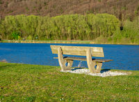 Wooden bench at Pfraundorfer Lake in the Altmuehltal valley