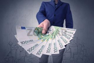 Businessman holding money