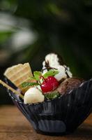 gourmet organic chocolate and strawberry ice cream sundae dessert
