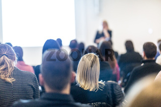 Woman giving presentation on business conference workshop.