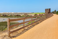 Coastal area in Portugal with path fence and hut