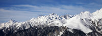 Panoramic view on snowy mountains in sun day