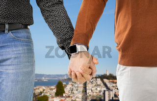 close up of male gay couple hands with smartwatch