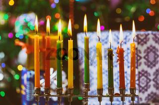 Closeup of a burning Chanukah candlestick with candles Menorah