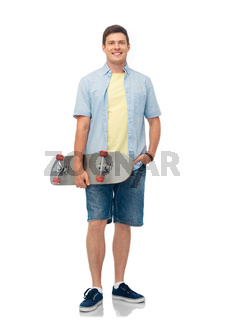 smiling young man with skateboard over white