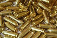 Heap of yellow brass gun bullets closeup