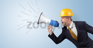 Young architect yelling with megaphone