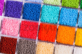 Various colour beads close up in the box