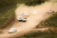 Traditional rally .The racing car drives into a steep turn, scattering, spraying dirt, dust. Extreme