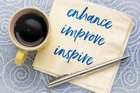enhance, improve, inspire concept on napkin