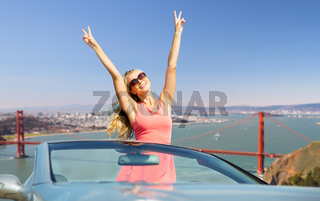 woman in convertible car over golden gate bridge
