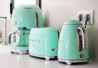 Torrevieja, Spain - June1, 2019: On kitchen counter top closeup in row SMEG brank kitchen appliances for easy life, coffee maker electric teapot and toaster oven, popular Italian manufacturer