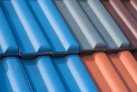 colorful clay roof tiles - closeup of massive roof tiles