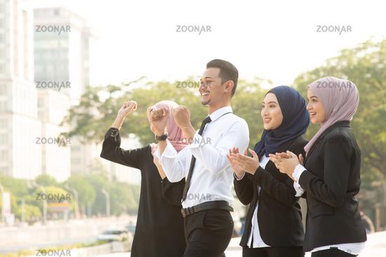 Muslim business people cheering