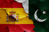 flags of Spain and Pakistan painted on cracked wall