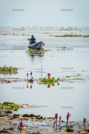Man in a boat at Songkhla lake