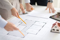 close up of architects with blueprint at office
