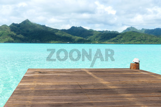 wooden pier on tropical beach in french polynesia
