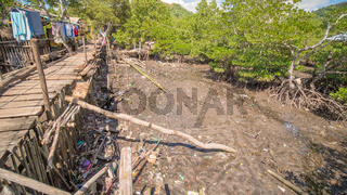 The bridge of the plaques in the poor district of Coron town. Busuanga. Views of the city's Slums from the river.