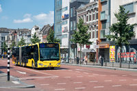 Cityscape Dutch city Utrecht with urban bus waiting for crossway