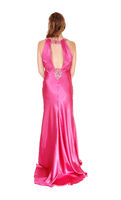 Gorgeous woman standing is a long pink dress from back