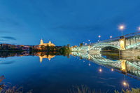 The Cathedral of Salamanca and the river Tormes with the Puente de Enrique Estevan at night