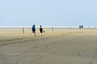 Visitors walking across the mudflats,Schleswig-Holstein Wadden Sea National Park,Westerhever Germany