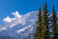 A snow covered mountain on a clear blue winter day in the Mountains at Black Prince Cirque in Kananaskis, Alberta