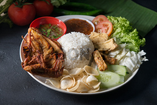 Nasi lemak kukus with fried chicken