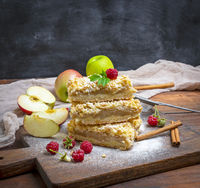stack of baked slices of pie with apples