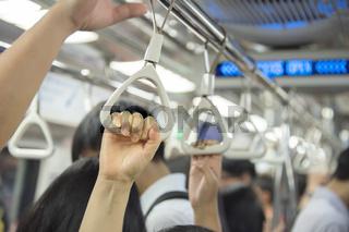 People at Singapore subway train