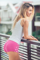 Beautiful woman at the balcony
