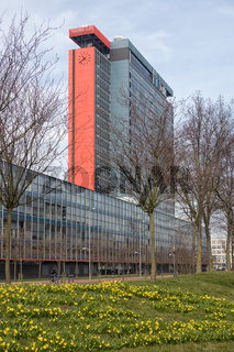 Campus Technical University Delft with buildings and field of narcissus