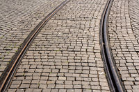 Steel rails set in granite cobblestone road in Porto