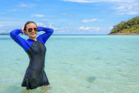 Asian teen girl is relax in the sea during travel to Ko Lipe, Thailand