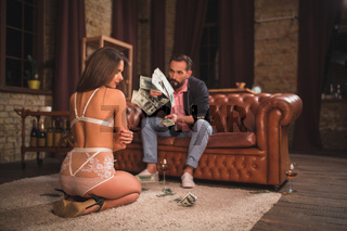 Businessman and his sexy assistant at office
