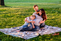Happy pregnant family of three expecting new baby