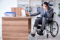 Male employee in wheel-chair in the office