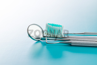 Dental instruments. Dentists tools and toothbrush.