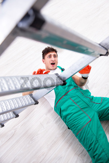 Young worker falling from the ladder