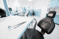 dentist chair in empty dental clinic interior