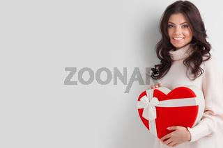 Woman holding heart shaped box