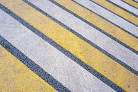 crosswalk on a asphalt road
