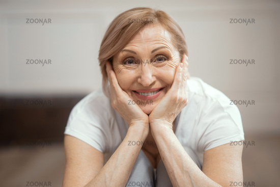 Close Up of a Smiling Woman Over 50 Finished Yoga Exercise.