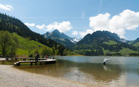 Schwarzsee, FR / Switzerland - 1 June 2019: tourists enjoy the summer lakeside view at the Schwarzse