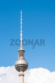 Television tower against blue sky with clouds in Berlin
