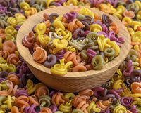 multicolored spiral raw pasta fusilli
