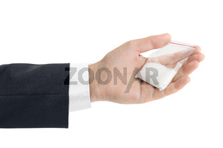 Hand and packet with narcotic